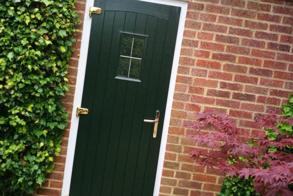 Green composite door installed in Old Basing