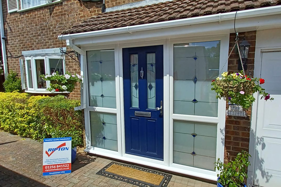 Steel blue composite door with side panels and matching glass